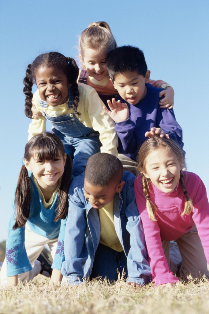 Stock Photo: 1574R-02723C Portrait of a group of children making a human pyramid