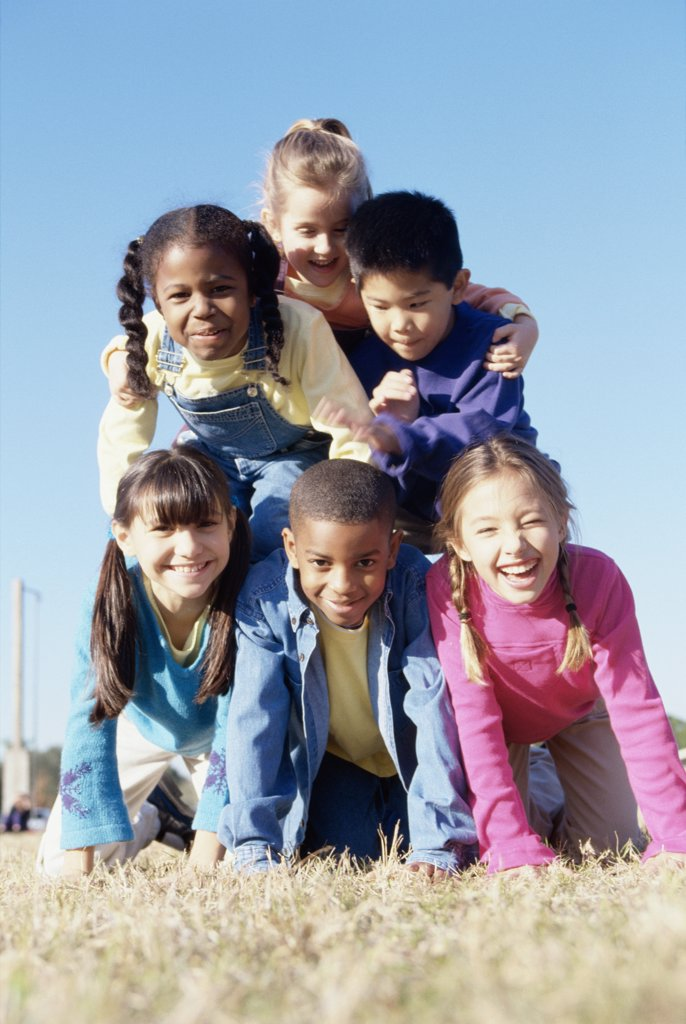 Portrait of a group of children making a human pyramid : Stock Photo