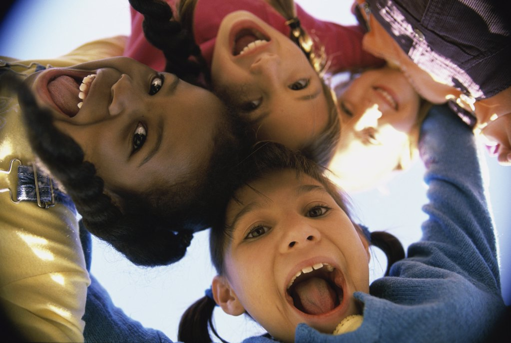 Stock Photo: 1574R-02725A Close-up of a group of children in a huddle