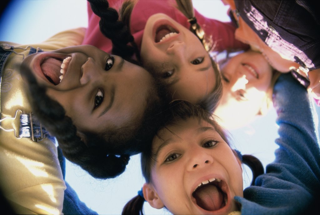 Stock Photo: 1574R-02725E Close-up of a group of children in a huddle