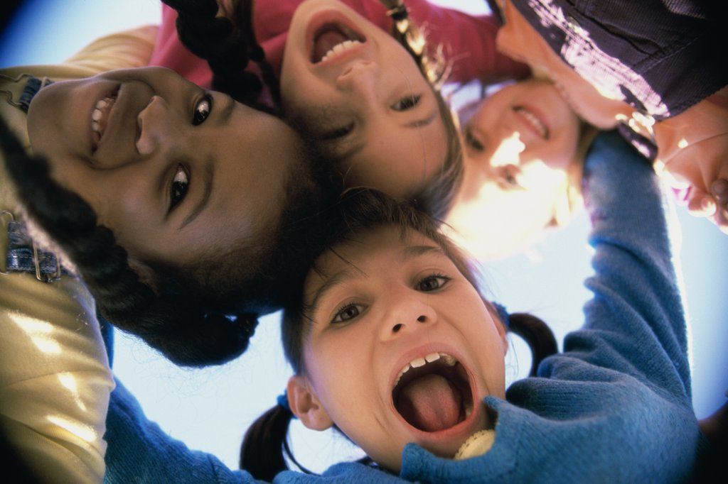 Close-up of a group of children in a huddle : Stock Photo