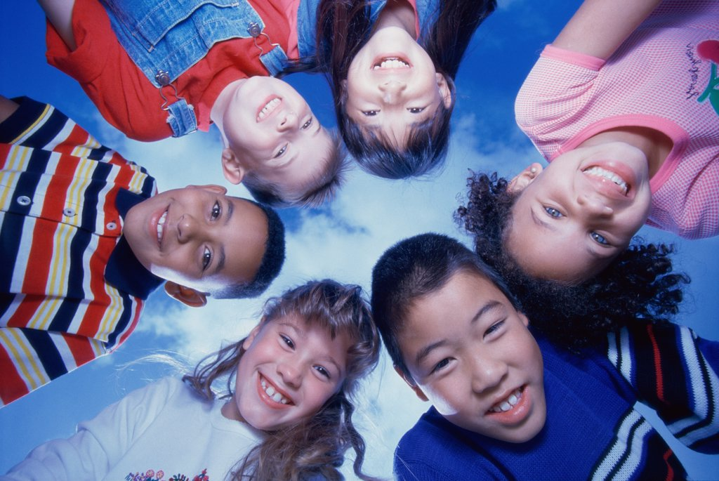 Stock Photo: 1574R-02790D Close-up of a group of children in a huddle