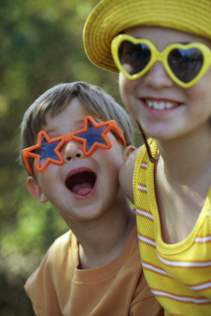 Stock Photo: 1574R-02845B Portrait of a boy and a girl in an amusement park