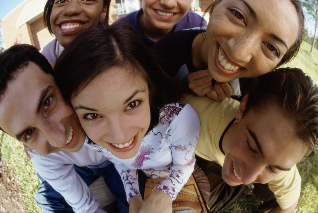 Portrait of a group of teenagers smiling : Stock Photo