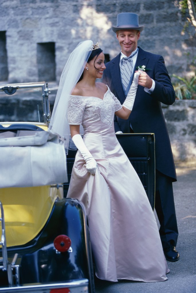 Stock Photo: 1574R-03060C Groom holding his bride's hand