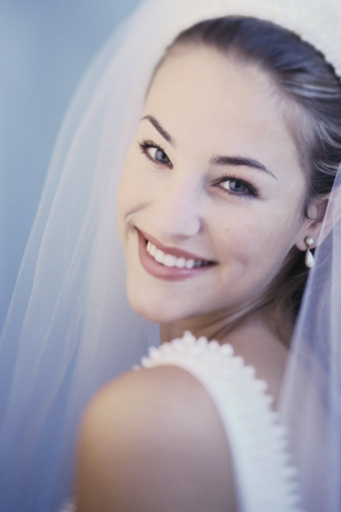 Stock Photo: 1574R-03113B Portrait of a bride smiling