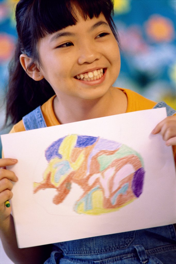 Close-up of a girl holding a painting : Stock Photo