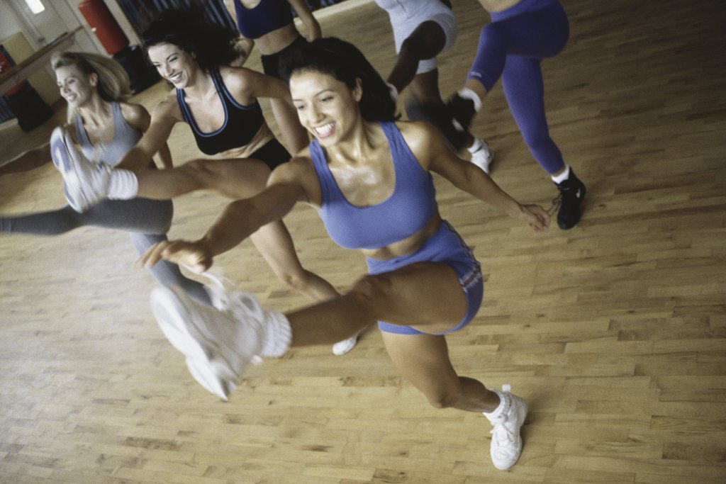 Stock Photo: 1574R-03465 High angle view of a group of young women exercising in an aerobics class