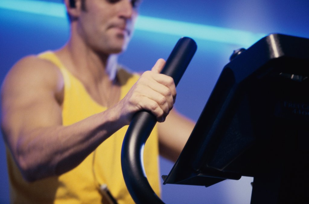 Stock Photo: 1574R-03484 Young man exercising