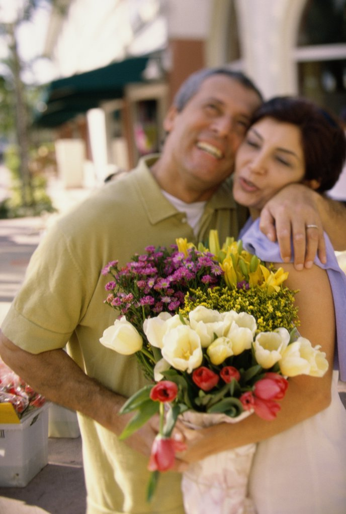Stock Photo: 1574R-0358H Mid adult couple holding each other