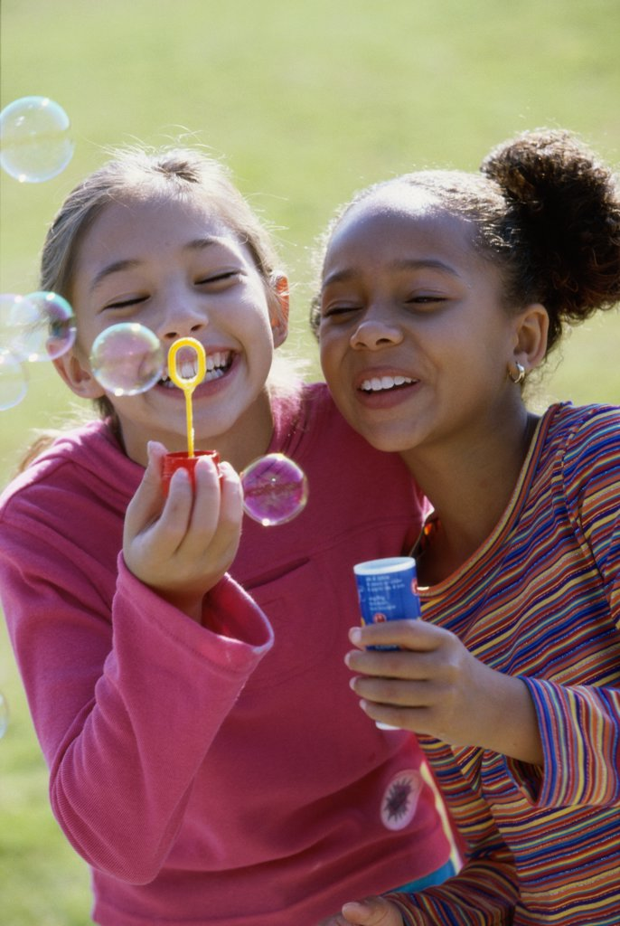 Stock Photo: 1574R-03670 Close-up of two girls blowing bubbles
