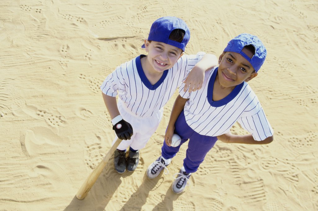 Portrait of two boys in baseball uniforms : Stock Photo