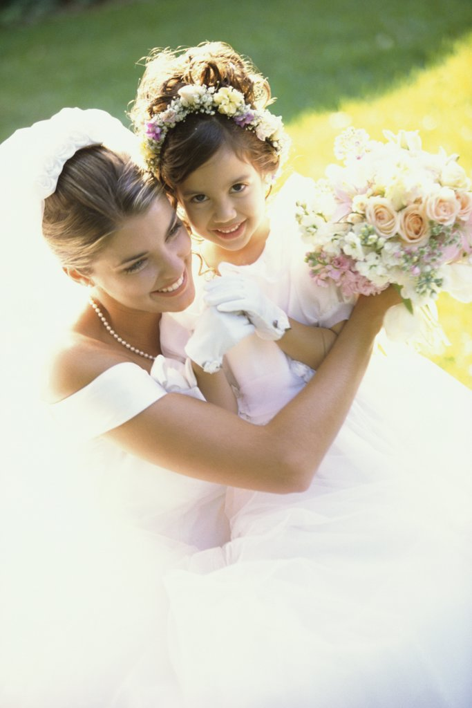 Stock Photo: 1574R-03874 High angle view of a bride smiling with a flower girl