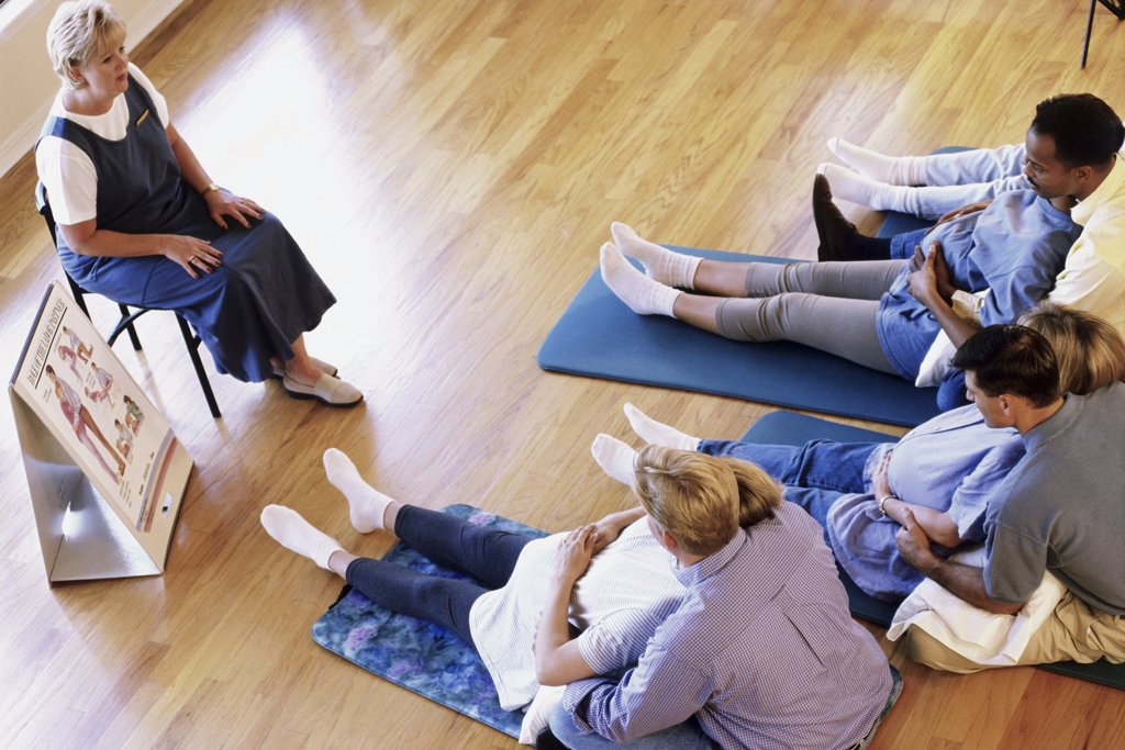 Stock Photo: 1574R-03979 Husbands and their pregnant wives at a prenatal class