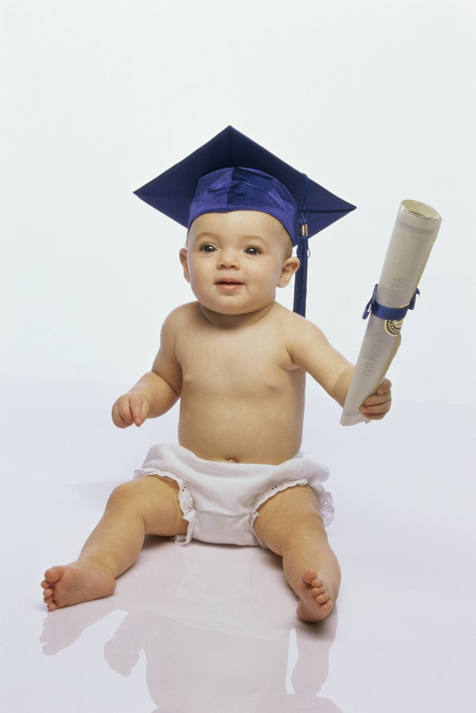 Baby boy wearing a mortar board holding a diploma : Stock Photo