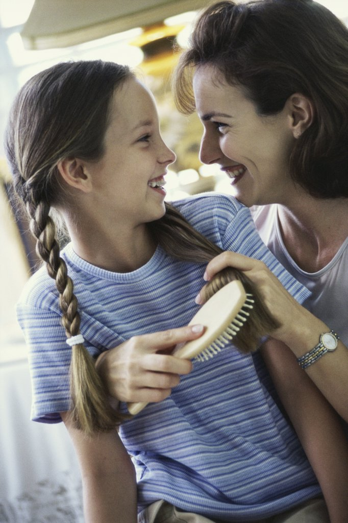 Stock Photo: 1574R-04227 Close-up of a mother looking at her daughter