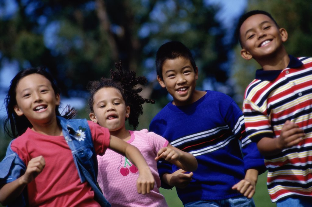 Stock Photo: 1574R-04314 Group of children running on a lawn