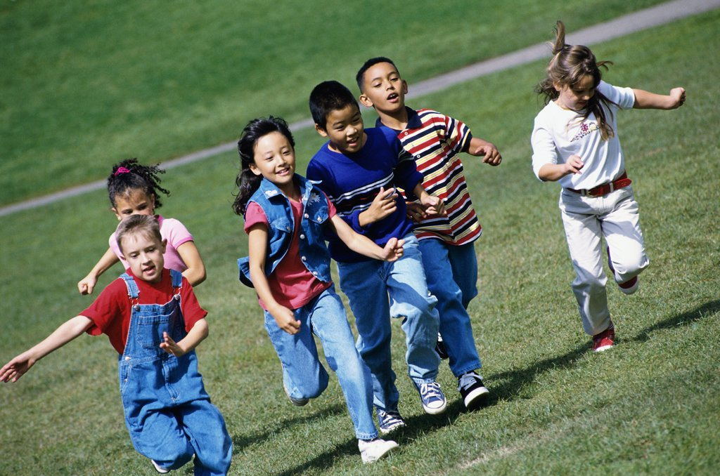 Stock Photo: 1574R-04315 Group of children running on a lawn