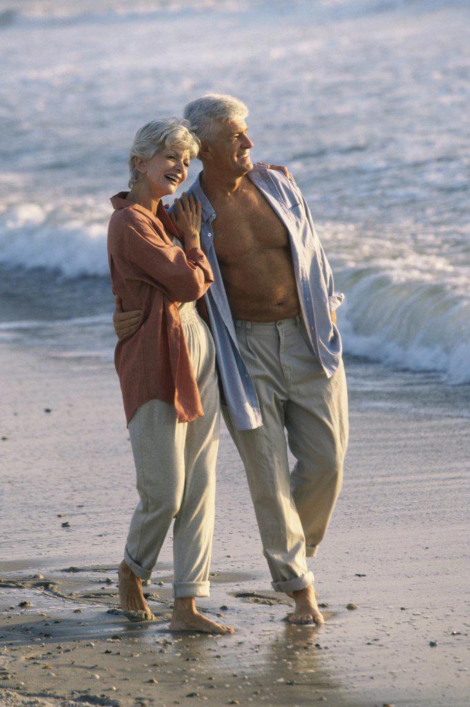 Stock Photo: 1574R-04437 Senior couple walking on the beach