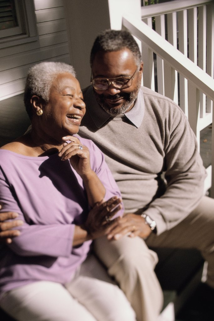 Senior couple sitting together on the stairs : Stock Photo