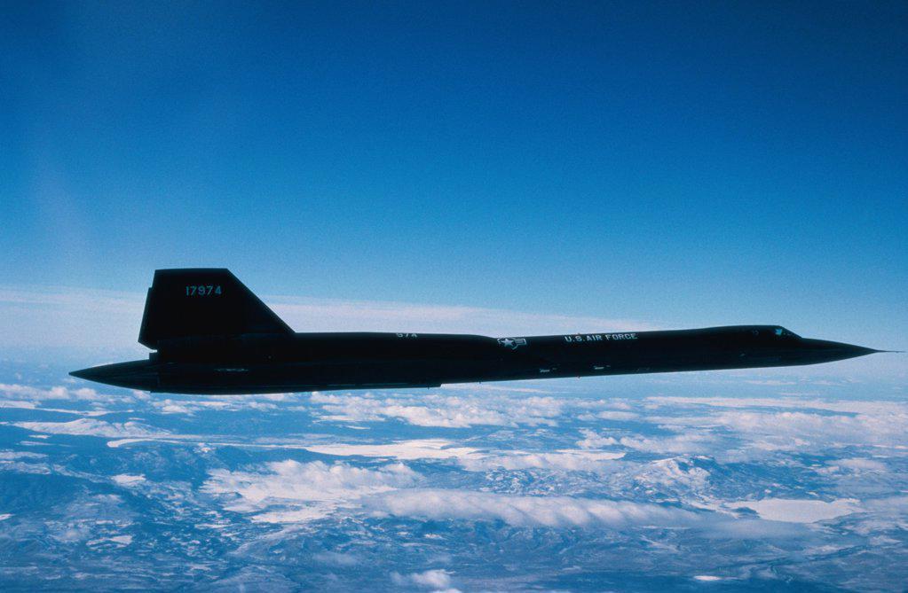 Side profile of an SR-71A Blackbird in flight : Stock Photo
