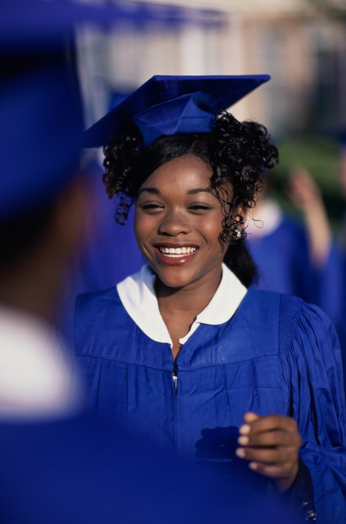 Portrait of a student wearing her graduation outfit : Stock Photo