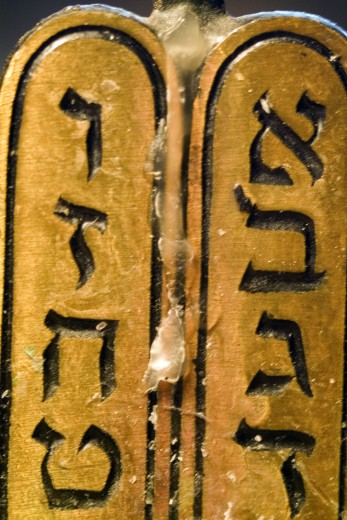 Close-up of Hebrew script on a menorah : Stock Photo