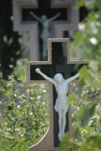 Jesus on a cross in a cemetery : Stock Photo