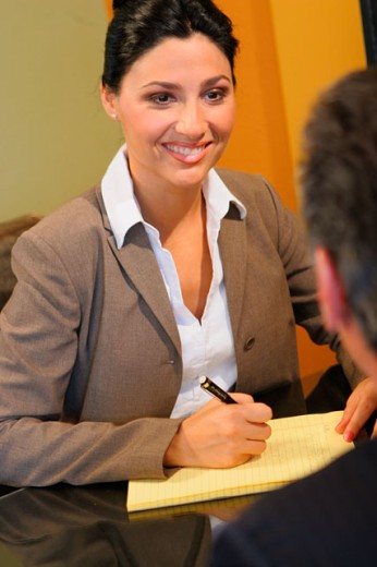 Stock Photo: 1574R-05445A Businesswoman looking at a businessman in an office