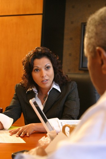 Stock Photo: 1574R-05461B Businesswoman talking to a businessman
