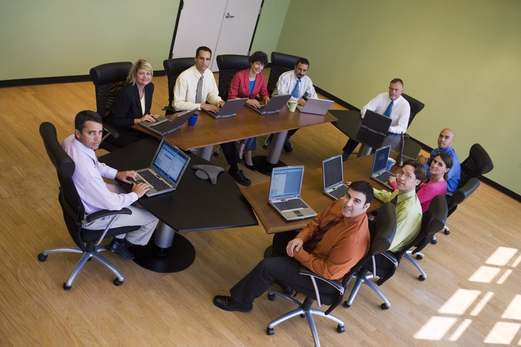 Stock Photo: 1574R-05494 Portrait of a group of business executives in a conference