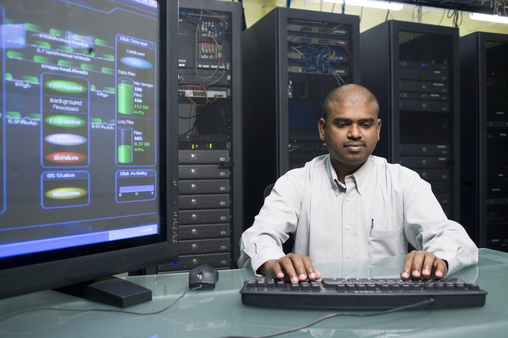 Stock Photo: 1574R-05505 Technician working on a network server
