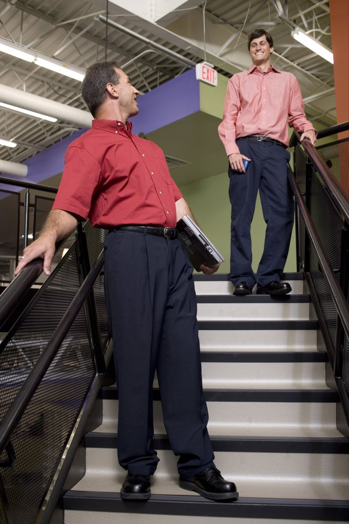 Stock Photo: 1574R-05582 Two businessmen talking on stairs