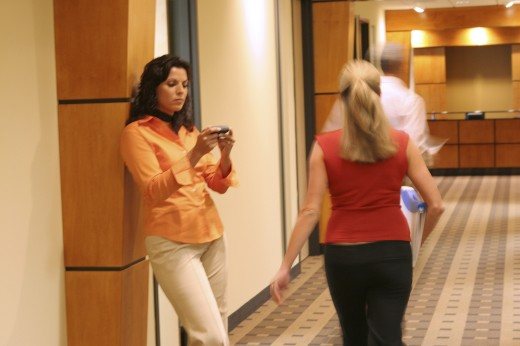 Businesswoman walking in a corridor : Stock Photo