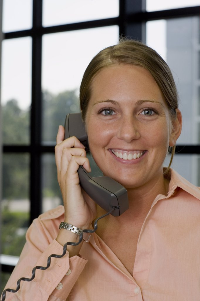 Stock Photo: 1574R-05865 Portrait of a businesswoman talking on a telephone