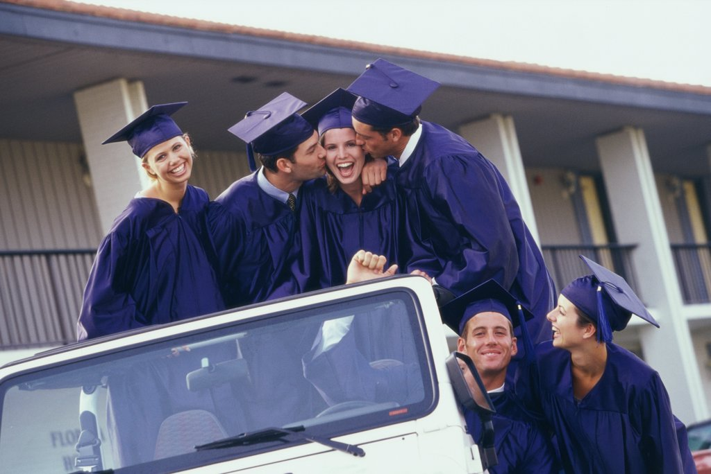 Stock Photo: 1574R-0617A Group of graduates in a jeep