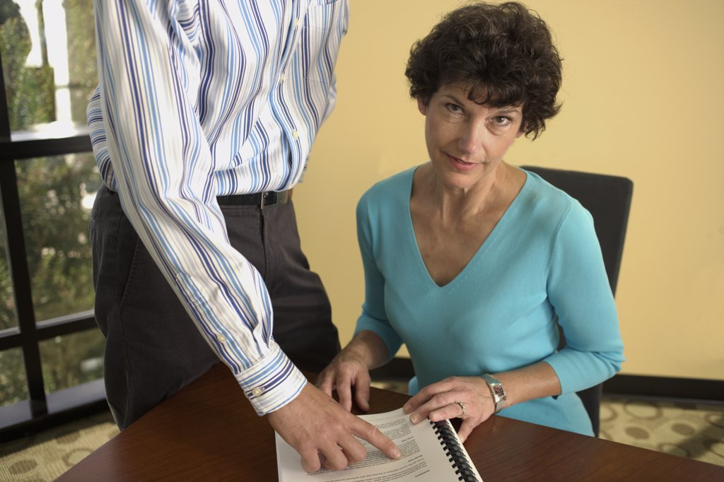 Stock Photo: 1574R-06319 Portrait of a businesswoman with a businessman in an office