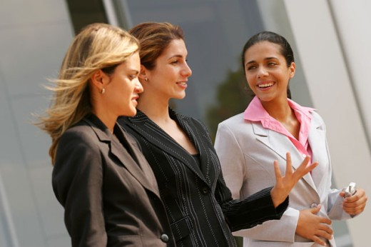Three businesswomen talking : Stock Photo