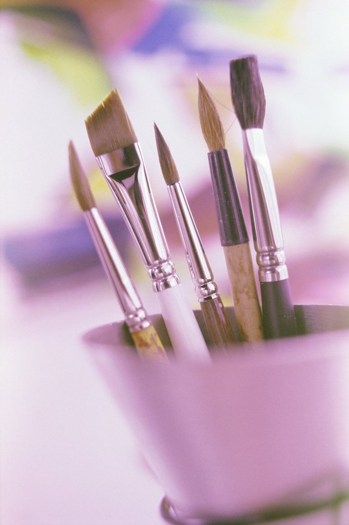 Stock Photo: 1574R-06927 Close-up of paintbrushes in a container