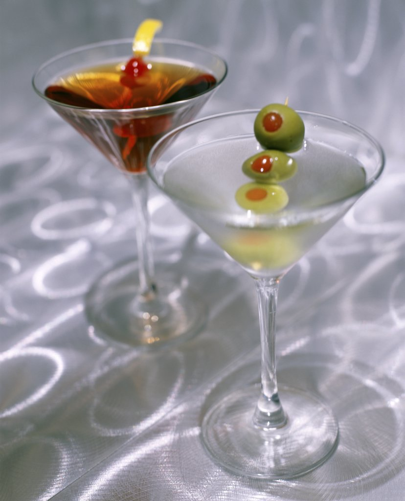 Green olives in martini glasses : Stock Photo