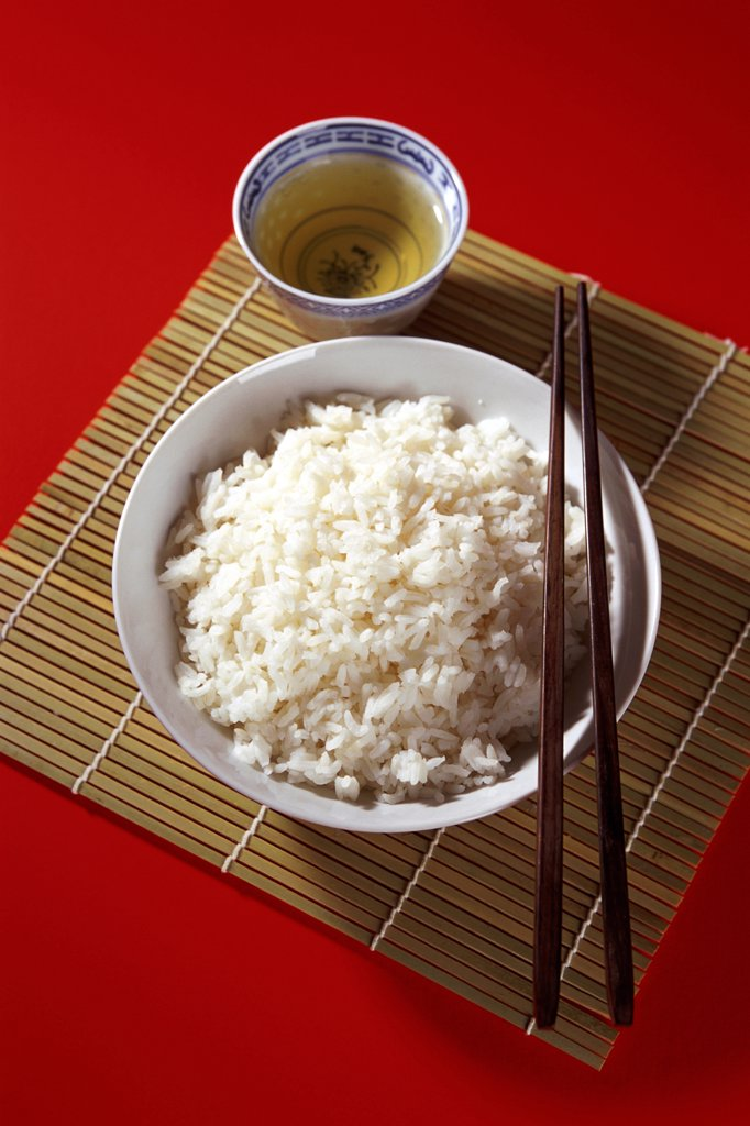 Bowl of rice with chopsticks : Stock Photo