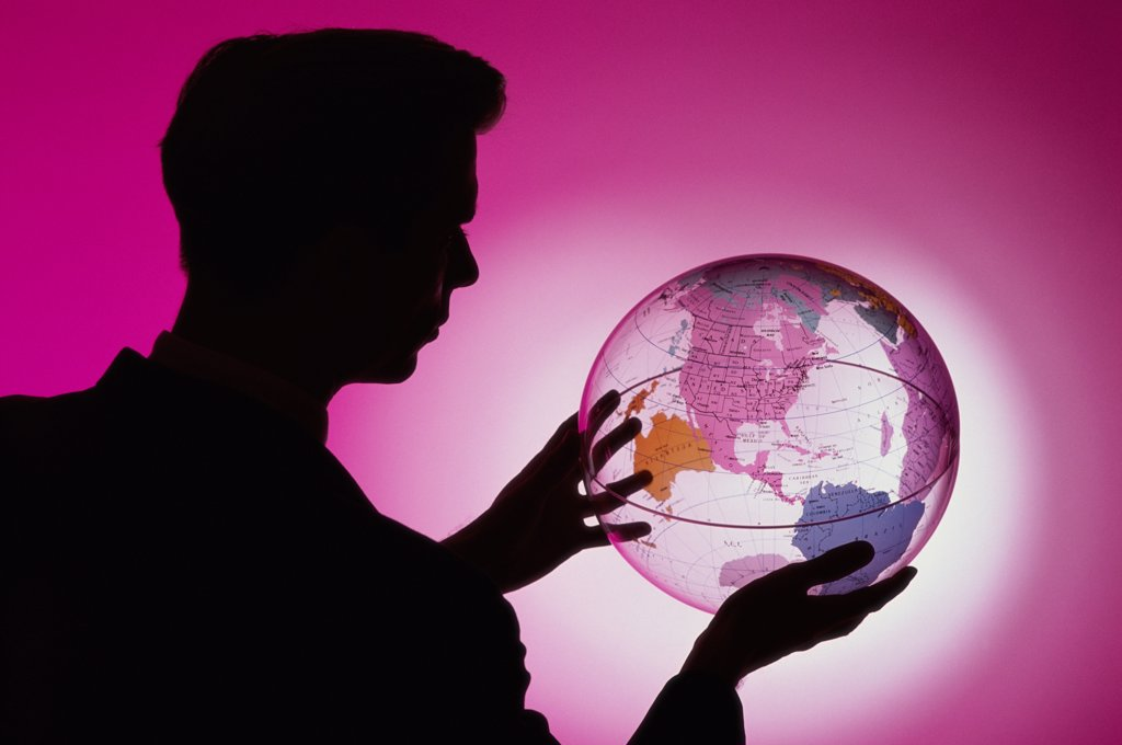 Stock Photo: 1574R-0702B Side profile of a businessman holding a globe