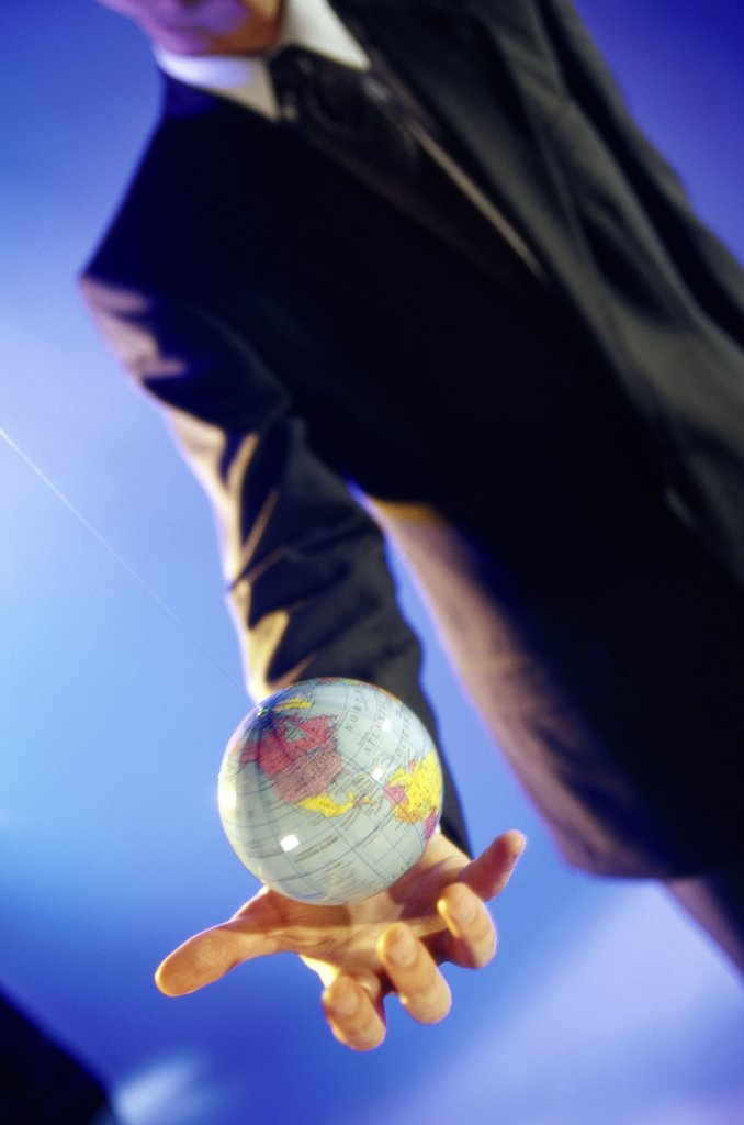 Businessman holding a globe : Stock Photo
