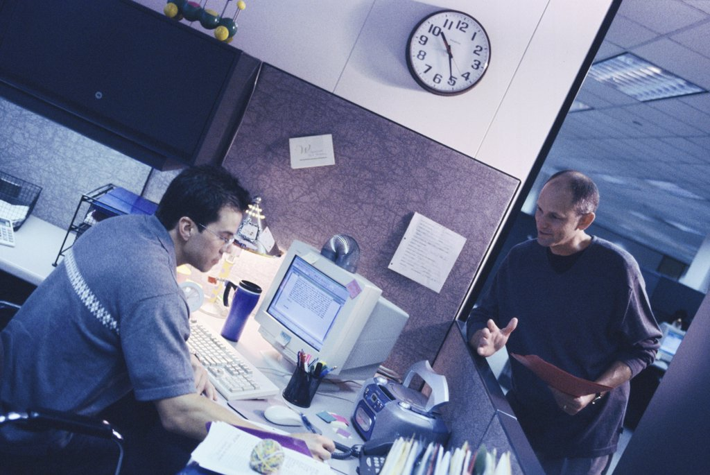 Stock Photo: 1574R-07352B Two businessmen in an office