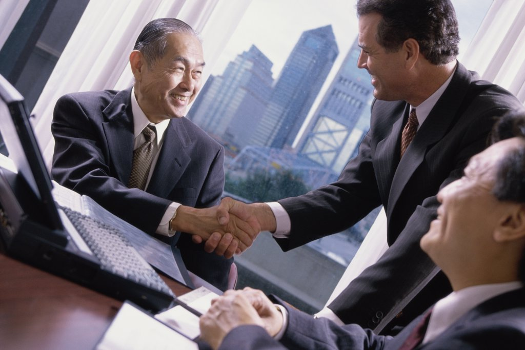 Stock Photo: 1574R-0767A Two businessmen shaking hands