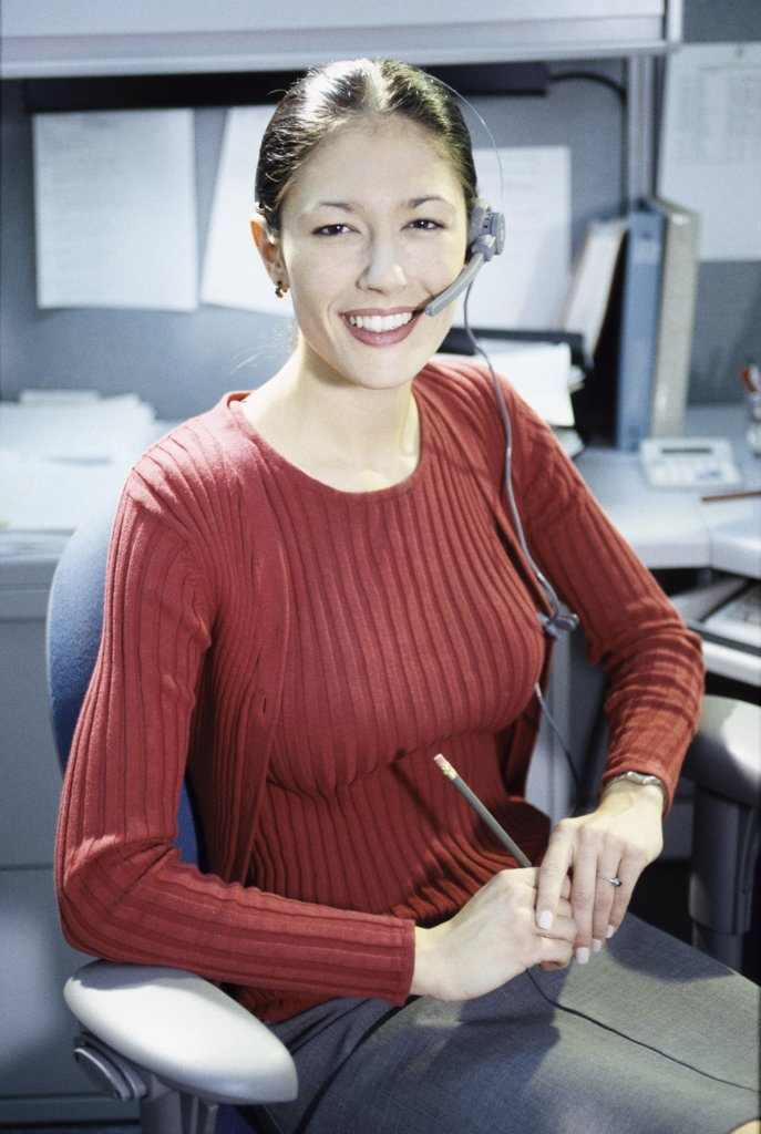 Portrait of a customer service representative wearing a headset : Stock Photo