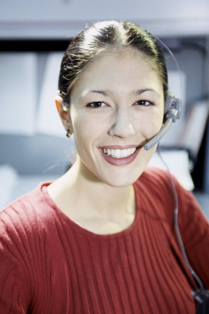 Stock Photo: 1574R-08010 Portrait of a customer service representative wearing a headset
