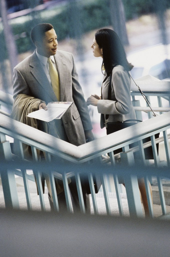Stock Photo: 1574R-08106B High angle view of a businessman and a businesswoman face to face
