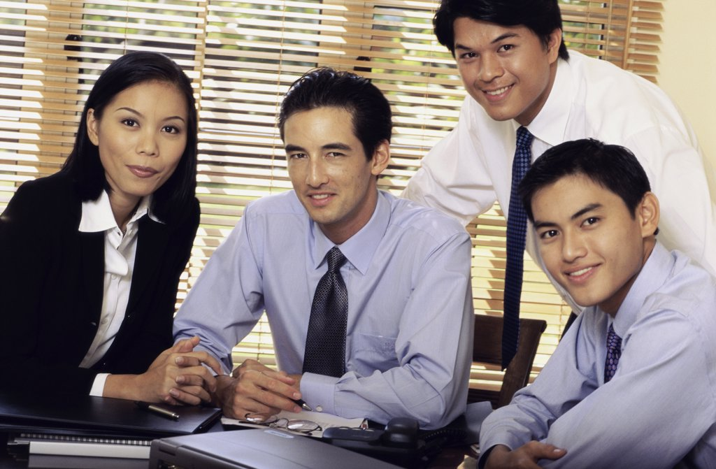 Portrait of a group of young business executives in an office : Stock Photo