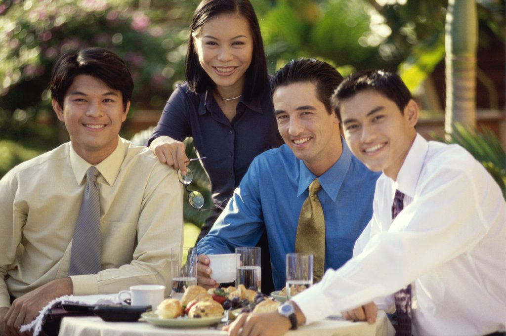 Portrait of a group of business executives smiling : Stock Photo